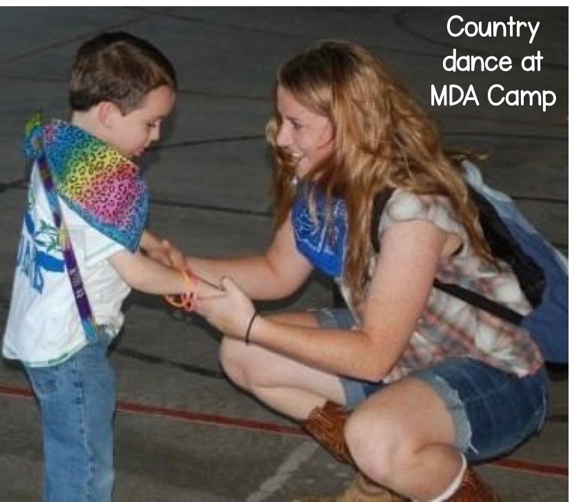 The author dancing with a little boy during a western dance at a summer camp.