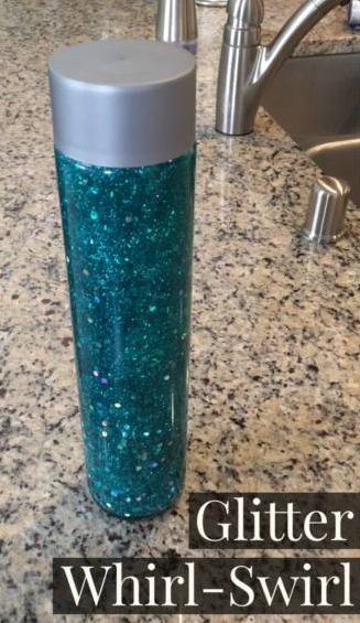 A blue glitter filled sensory bottle