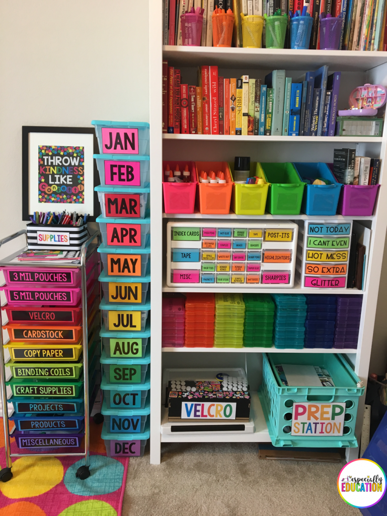 My rainbow colored storage drawers and containers next to my shelf of books filed by color